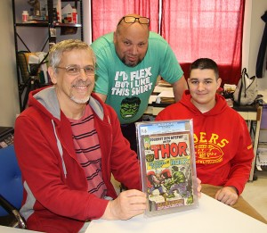 Ted, Jose and Joe with our 100,000th book: Tales of Suspense 39, GCG 9.6